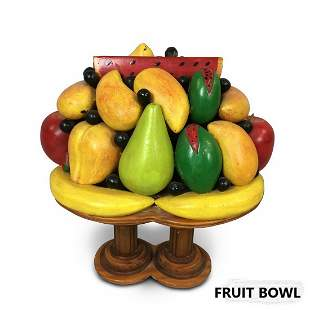 A SKILLFULLY CARVED BOWL OF FRUIT