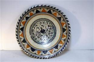 Scarce Dutch majolica charger with stylized scroll