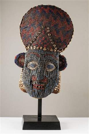 Beaded Red and Blue Helmet Mask and Kauris decorated