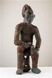 Beaded Royal Figure holding Wine Vessel