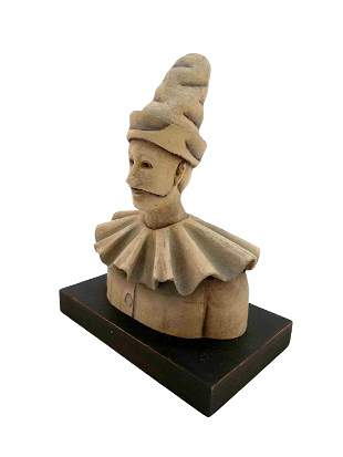 Intriguing clown bust on wooden base - home decor