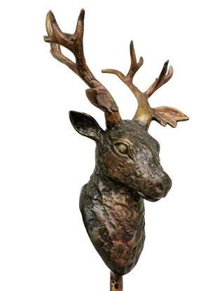 Bronze deer head on stand