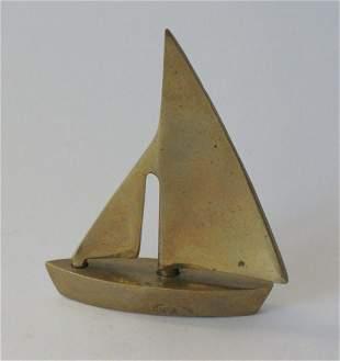 Vintage brass sailboat paper weight