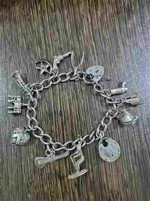 1974 British sterling silver multi-treasure string