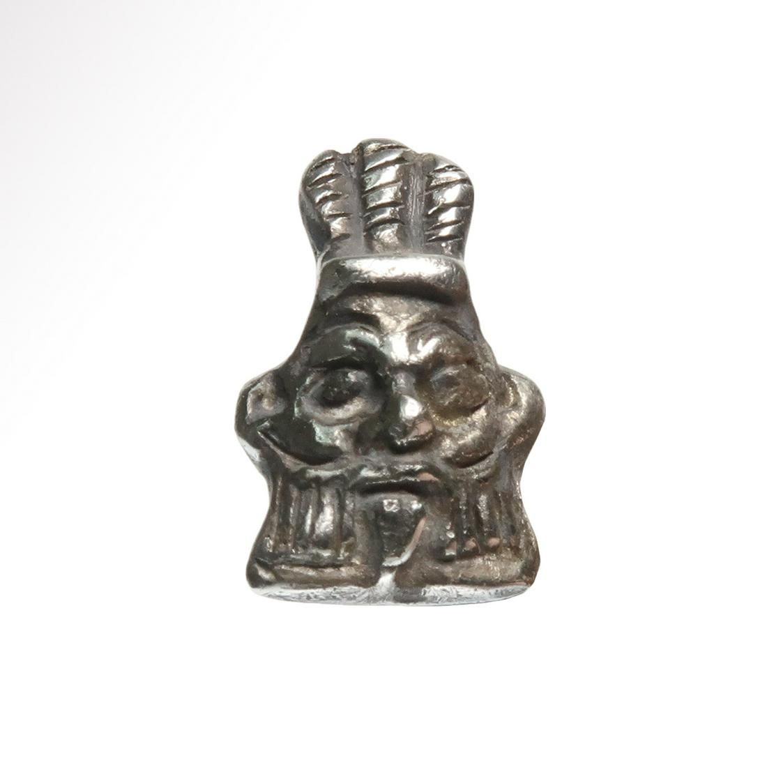 Egyptian Solid Silver Bes Head Amulet, c. 350 B.C.