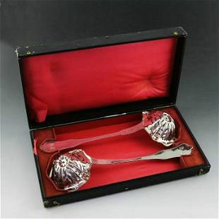 Pair of 19th century French sterling silver colanders