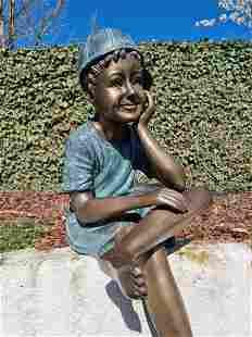 Bronze garden sculpture - Dreaming boy with cap -
