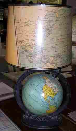 """Untitled (6"""" world globe mounted as a lamp.)"""