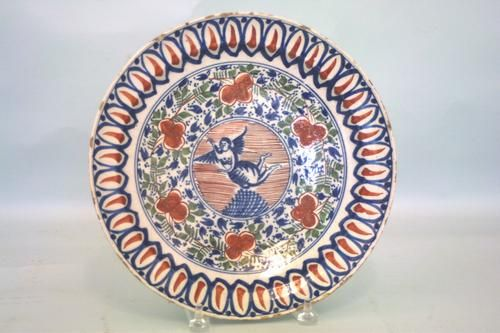 A fine scarce early 18th century Dutch delft charger in