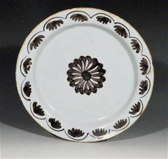 Manganese decorated Lambeth delftware plate