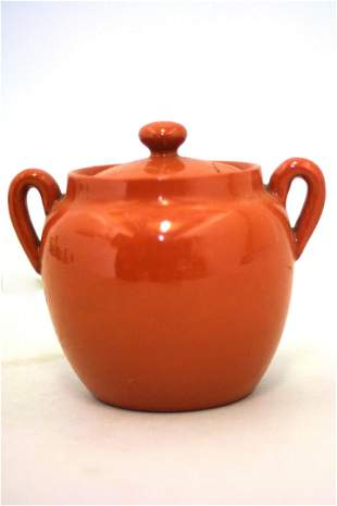A mini redware bean pot