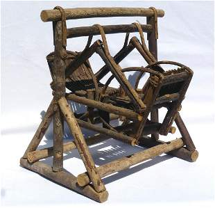 A rustic, miniature twig double swing or glider.