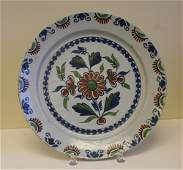 A mid 18th century Bristol delft charger in the red,