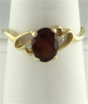 LADIES 10K YELLOW GOLD 1 1/2ct OVAL SYNTHETIC GARNET