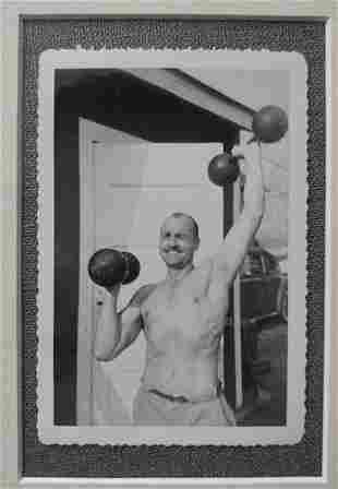 1960's Shirtless Man Lifting Dumbells