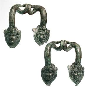 Two Greek Bronze Hydria Handles with Heads of Pans