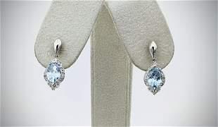 Sterling Silver Sky Blue Topaz & Diamond Earrings
