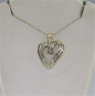 10K YELLOW GOLD BAGGUETTE 1/3ct DIAMOND HEART PENDANT