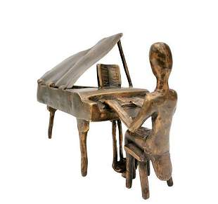 Bronze figure of a man at the piano - Piano player -