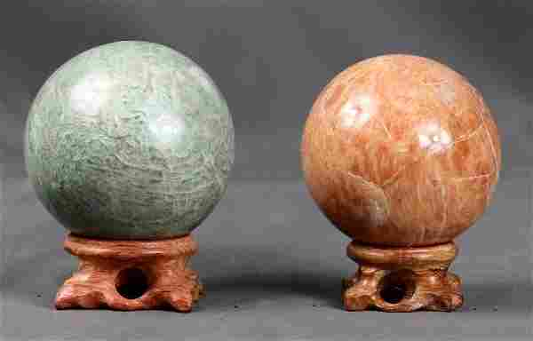 Amazonite and Moon stone spheres on wooden stand