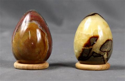 Two breathtaking polished eggs on wood ring