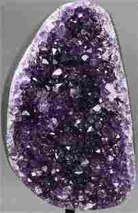Dark violet amethyst from Uruguay displayed on an
