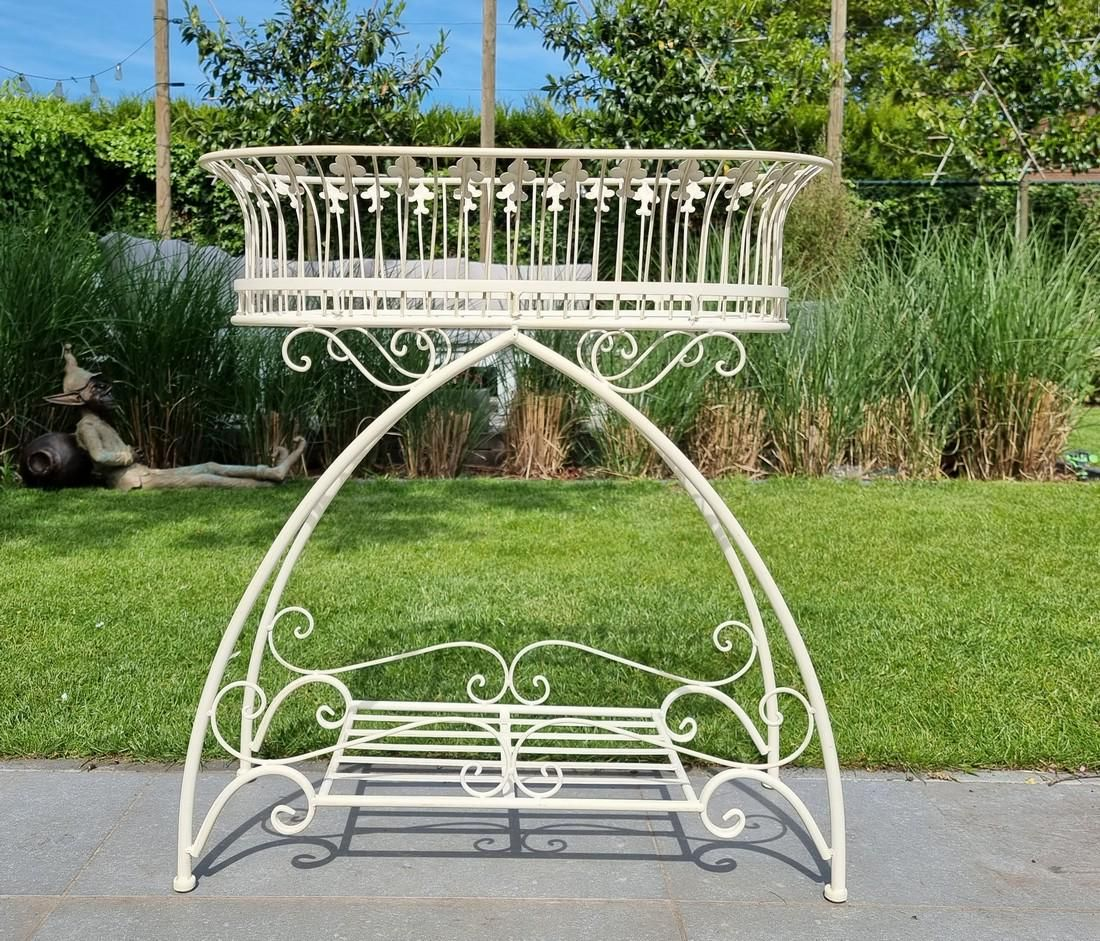 Large wrought iron flower rack planter on stand