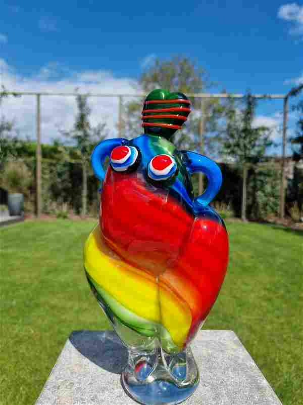 Colorful glass sculpture of an abstract woman