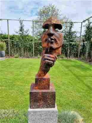 Large abstract sculpture of a male 'whispering' -