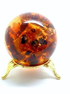 Extraordinary Amber Ball on a pedestal with insect