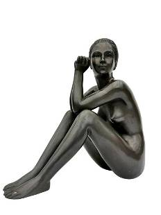 Bronze sculpture of a sitting woman