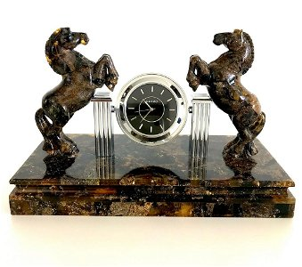Collectible Baltic amber clock with hand carved horses