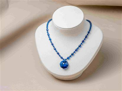 Blue amber necklace with pendant