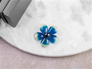 Blue amber brooch