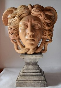 Medusa, in antique yellow marble from the late 19th