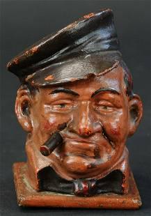 CAST IRON SAILOR SMOKING A CIGAR ORIGINAL PAINT