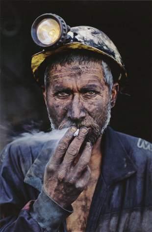 STEVE MCCURRY - Coal Miner Smoking, Afghanistan