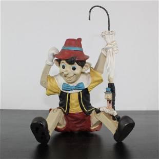 Pinocchio with Jiminy Cricket statue