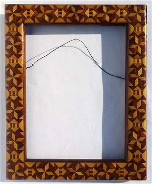 A Beautiful and unusual marquetry frame