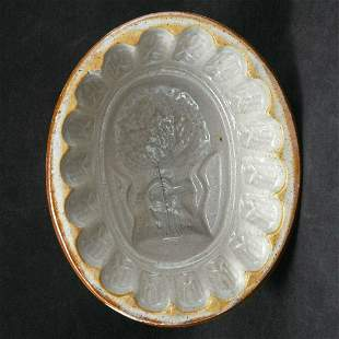 Small dark Victorian food mold with wheat sheaf design