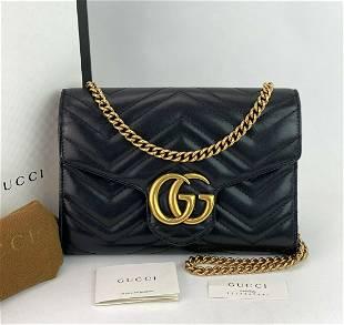 Gucci GG Marmont Black Leather Matelassé Wallet on a