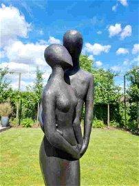 Bronze garden sculpture of an embracing couple -