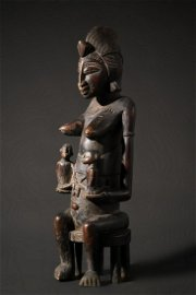 A remarkable seated Senufo maternity