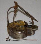 A very scarce Pennsylvania iron betty lamp