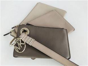 MICHAEL KORS Trio of clutch bags in one with handle