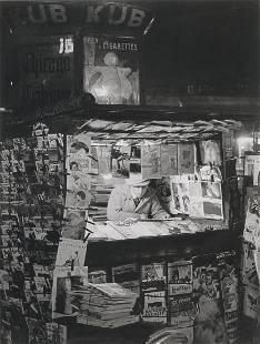 BRASSAI - Newsstand, Paris, 1930