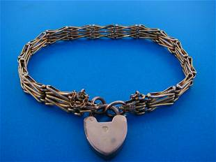 CHARMING 9k Rose & Yellow Gold Heart Charm Bracelet