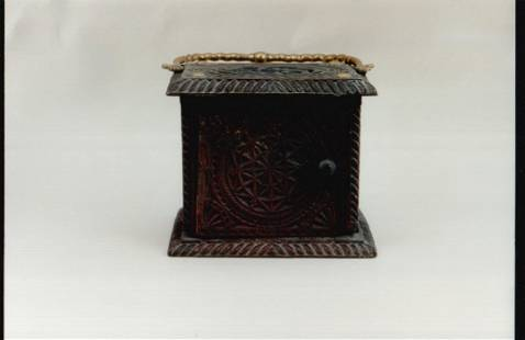 A good wooden Fresian carved foot warmer with a brass