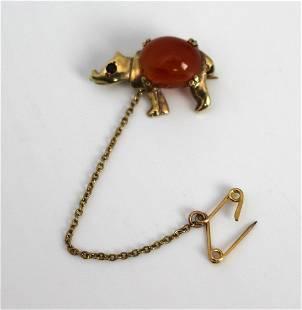 Gold Rhino Form Brooch with Carnelian & Ruby Eyes