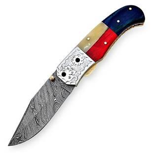 Work pocket holding everyday damascus steel knife wood